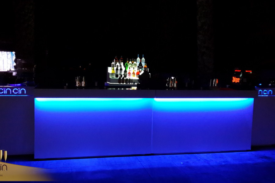 White Mobile Bar rental in blue light